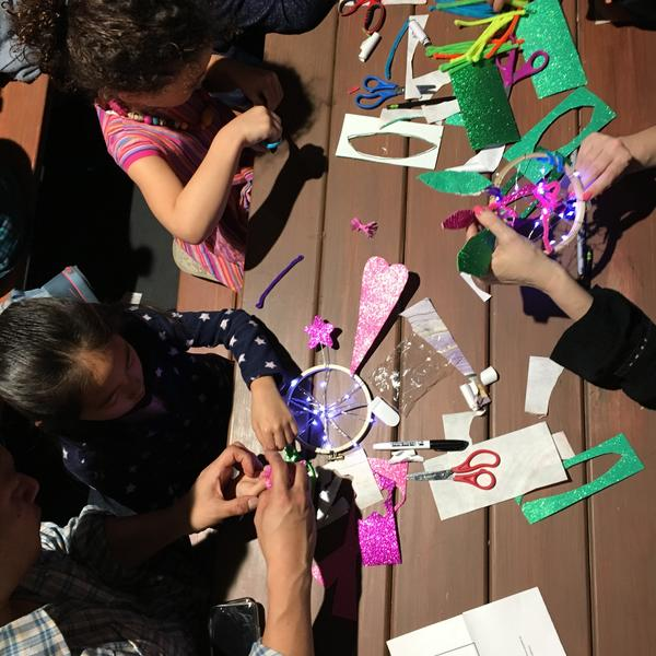 children making crafts on a table